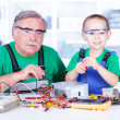 Stock Photo: Grandchild disassembling PC power supply