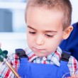 Stock Photo: Child playing with soldering iron and resin