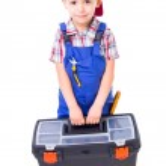 Little handyman carrying toolbox — Stock Photo #35718913