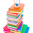 Stock Photo: Stacked books and hourglass