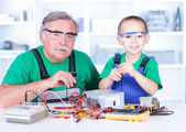 Grandchild disassembling PC power supply — Stock Photo
