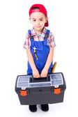 Little handyman carrying toolbox — Stock Photo