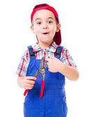 Boy showing shear cutting scissors hazard — Stock Photo