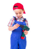 Little handyman with drill — Stock Photo