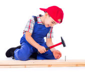 Little carpenter nailing — Stock Photo