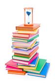 Yığılmış kitaplar ve kum saati — Stok fotoğraf