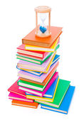 Stacked books and hourglass — Stock Photo