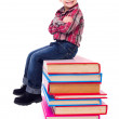 Little boy sitting on stacked colorful books — Stock Photo #42799449