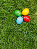 Colorful easter eggs in grass — Stock Photo