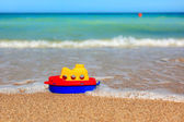 Little toy ship on beach — Stock Photo