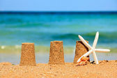 Three sand towers on beach — Stock Photo