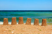 Summer script on sand towers — Stock Photo