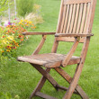 Stock Photo: A wooden chair on green grass