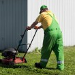 Lawn mower man working — Stock Photo #13146837