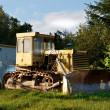 Old dirty yellow bulldozer — Stock Photo