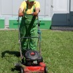 Lawn mower man working — Stock Photo