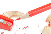 Red pencil and sharpener — Stockfoto