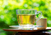 Cup of tea on nature background — Stockfoto