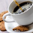 Coffee and oatmeal cookies on wooden table — Stock Photo #18469571