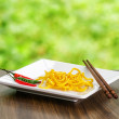 Egg noodles on nature background — Stock Photo #18469595
