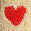 Stock Photo: Red heart sign in yellow sand