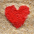 Royalty-Free Stock Photo: Red heart sign in yellow sand