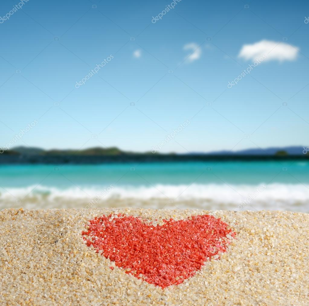 Red heart sign in yellow sand. — Stock Photo #18682777