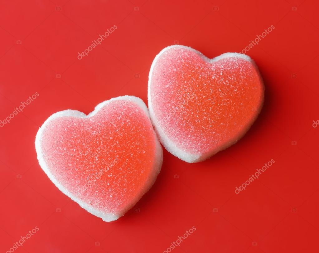 Sugar hearts on red background. Valentine concept. — Stock Photo #18682865