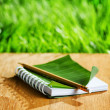 Notepad lies on wooden board — Stock Photo