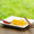 Egg noodles on nature background — Stock Photo #19861435