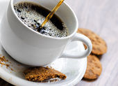 Coffee and oatmeal cookies on wooden table — Stock Photo