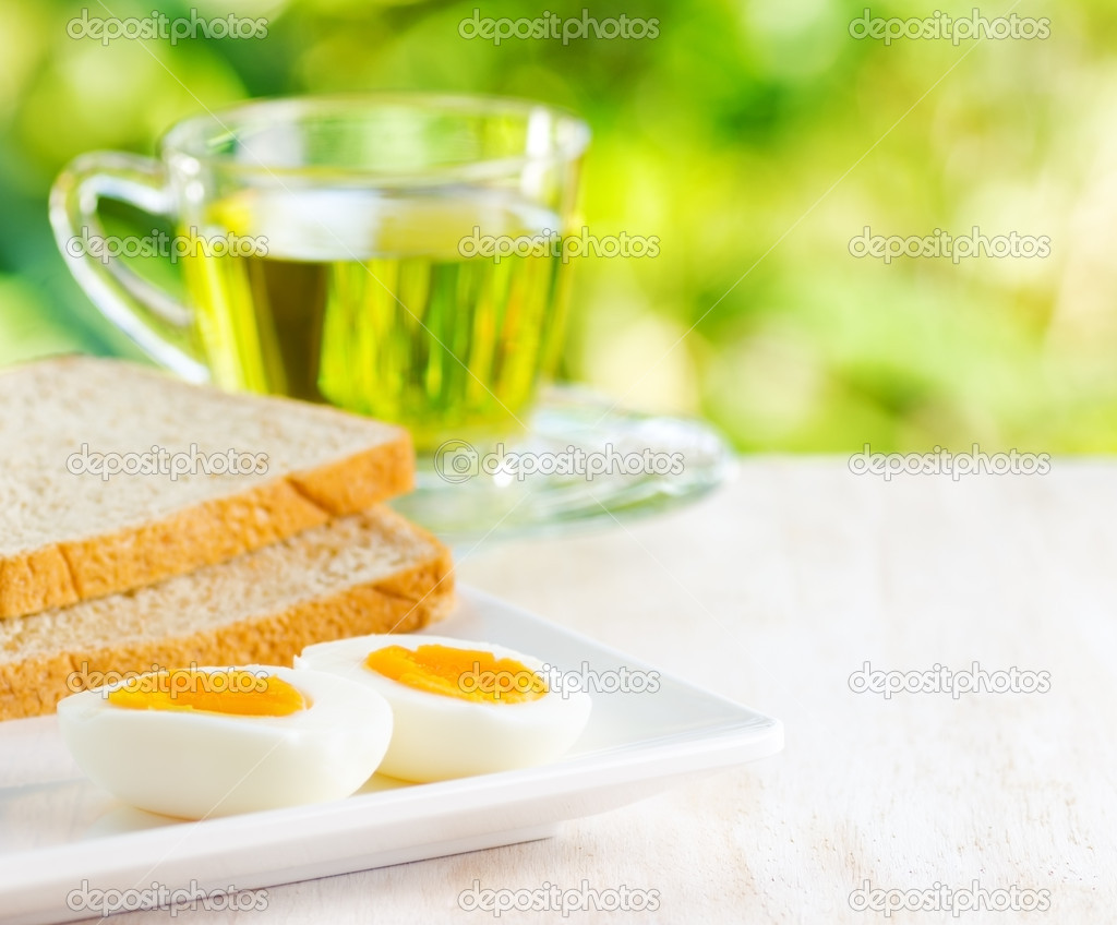 Boiled eggs, toasts and cup of tea. — Stock Photo #20141979
