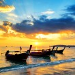 Traditional thai boats at sunset beach — Stock Photo #20810017
