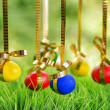 Easter eggs hanging on golden ribbons — Stock Photo #21068665