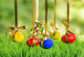 Easter eggs hanging on golden ribbons — Stock Photo