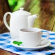 Cup of tea on wooden table — Stock Photo