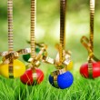 Easter eggs hanging on golden ribbons — Stock Photo #21298479