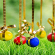 Easter eggs hanging on golden ribbons — Stock Photo #22200767