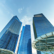 Skyscrapers in financial district of Singapore - Stock Photo