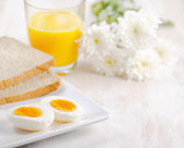 Boiled egg, toasts and orange juice. — Stock Photo