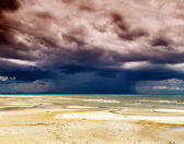 Stormy sky and beach at low tide — Stock Photo