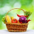 Royalty-Free Stock Photo: Fresh vegetables in the basket on wooden table
