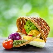 Fresh vegetables in the basket on wooden table — Stock Photo #23636063