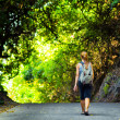 Young woman hiking with backpack — Stock Photo #23908137