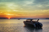 Motorboat at sunset. Beautiful landscape — Stock Photo
