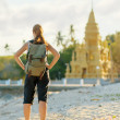 Young woman looking at golden pagoda. Hiking at Asia - Stockfoto