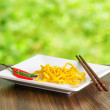 Egg noodles on nature background — Stock Photo #24104075