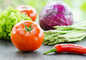 Various vegetables on wooden table — Stock Photo