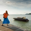 Young woman with suitcase on the pier — Stock Photo #24179585