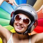 Funny girl in helmet having fun. Multicolored background — Stock Photo #24179927